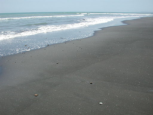Glistening_black_sand_beach_at_White_Cliffs