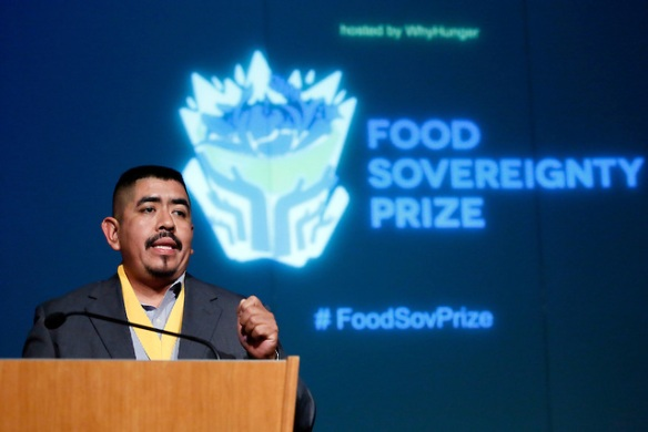 Lucas Benitez, co-director of the Coalition of Immokalee Workers from the United States, makes his acceptance speech after being honored at WhyHunger's 2012 Food Sovereignty Prize, which honors grassroots leaders working for a more democratic food system, New York, Wednesday, Oct. 10, 2012. (Stuart Ramson/Insider Images for WhyHunger)