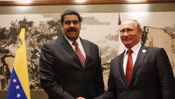 Venezuelan President Nicolas Maduro (L) and Russian leader, Vladimir Putin (R).